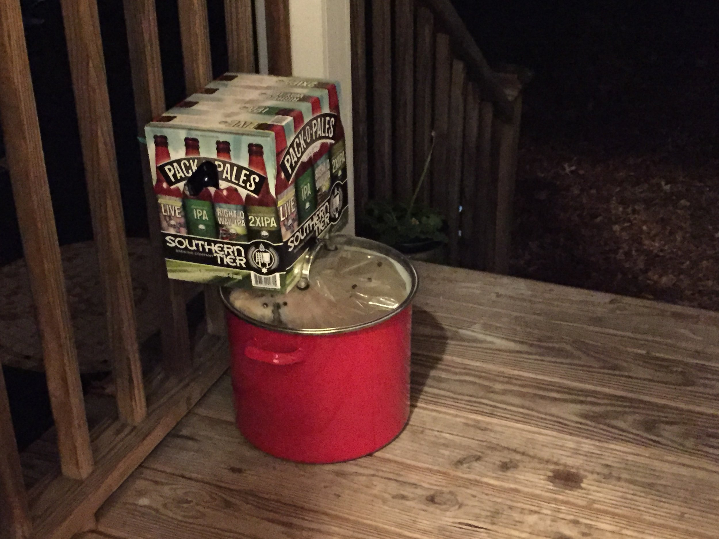 Our turkey, brining away in cold temperatures on the back porch. Lid secured with a case of beer, which is itself being kept cold until needed for football viewing the following day.