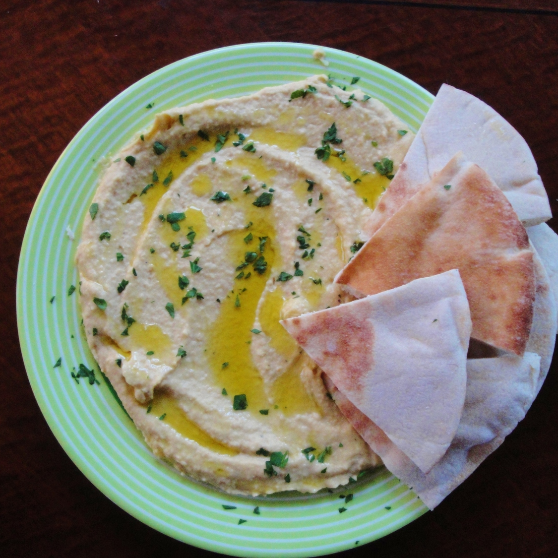 Classic Hummus in the Adventure Kitchen, with pita and a sprinkle of parsley
