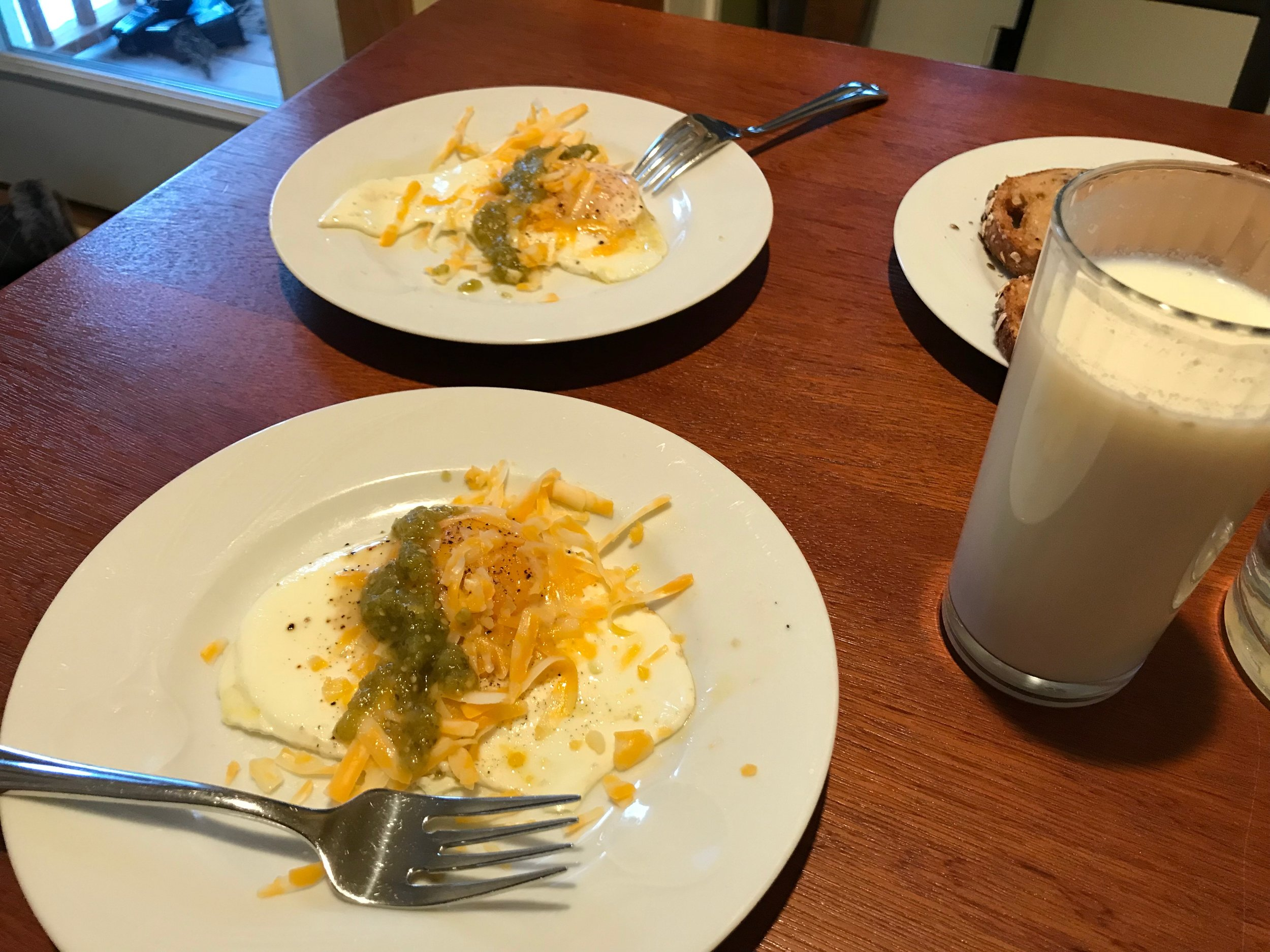 A quick pic of our breakfast: fried eggs topped with shredded colby/jack cheese and salsa. Super yummy.