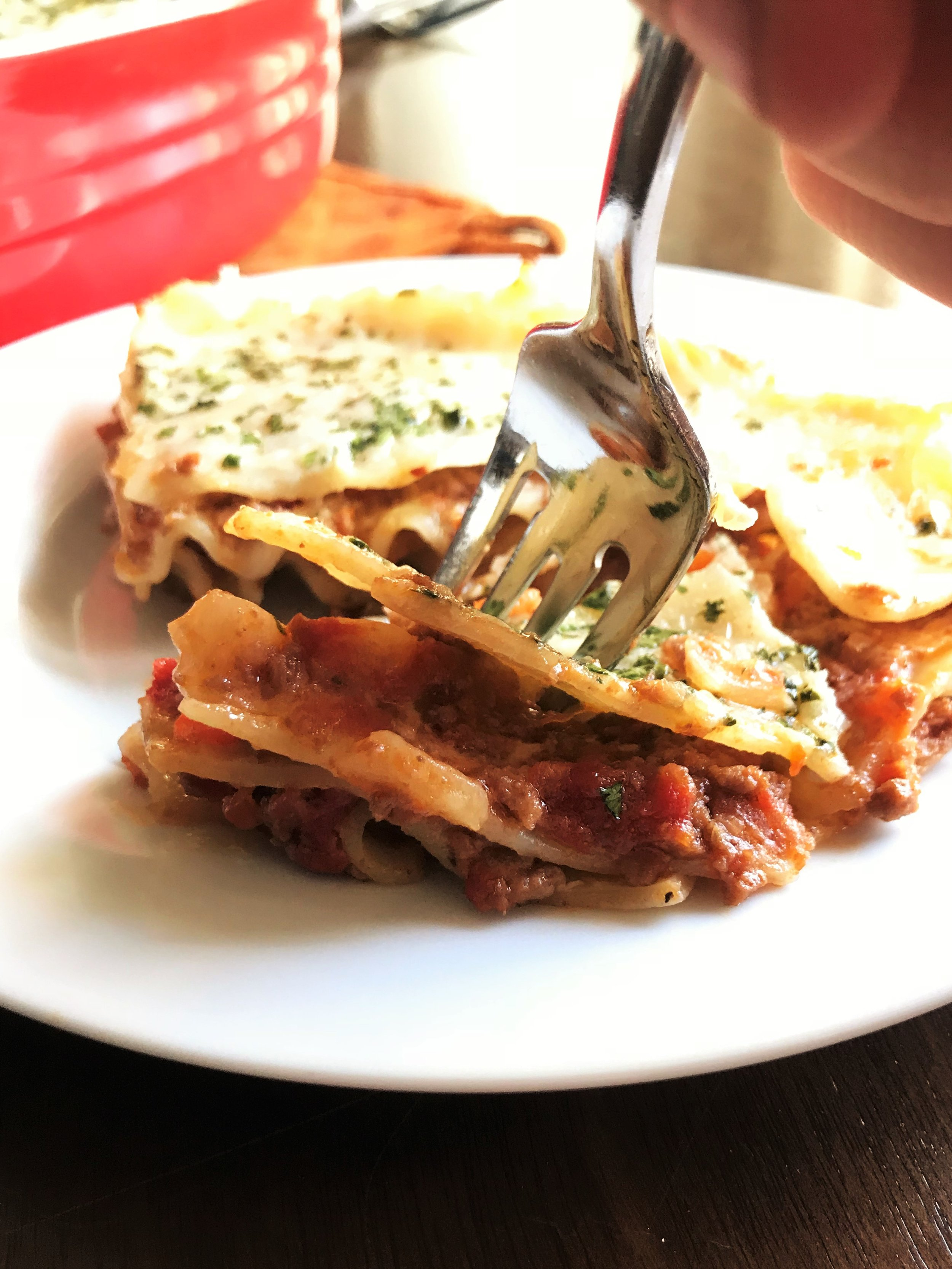 Digging in to that Classic Lasagna. The layers, the pasta, the Parmesan, the creamy goodness, the meaty deliciousness.... My oh my.