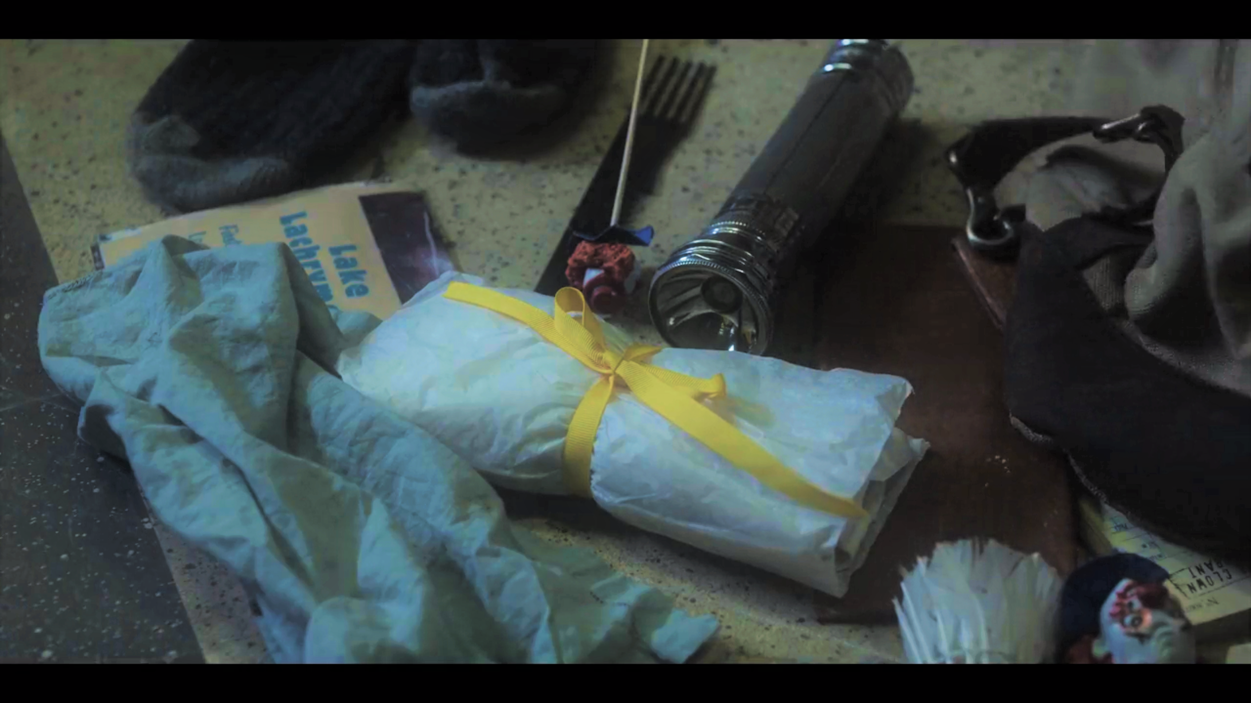 """This is a photograph of the actual burrito Larry carried with him to Prufrock Preparatory School on that fateful day, seen here among the detritus of his backpack. (Detritus is a word which here means, """"the remnants of his Lake Lachrymose culinary career, and other assorted paraphernalia."""")"""