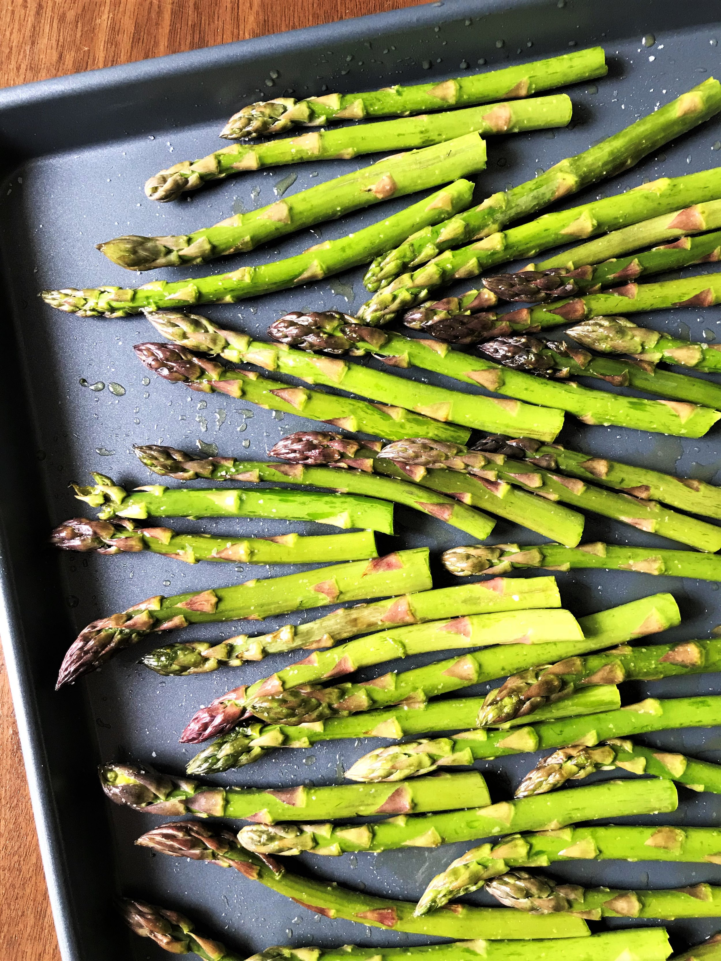 We used medium-sized asparagus stalks for this. Tossed with the oil and salt and ready for the oven in the Adventure Kitchen.