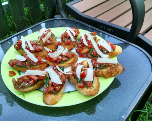 A plate of Tomato-Basil Crostini, ready to party in the Adventure Kitchen.