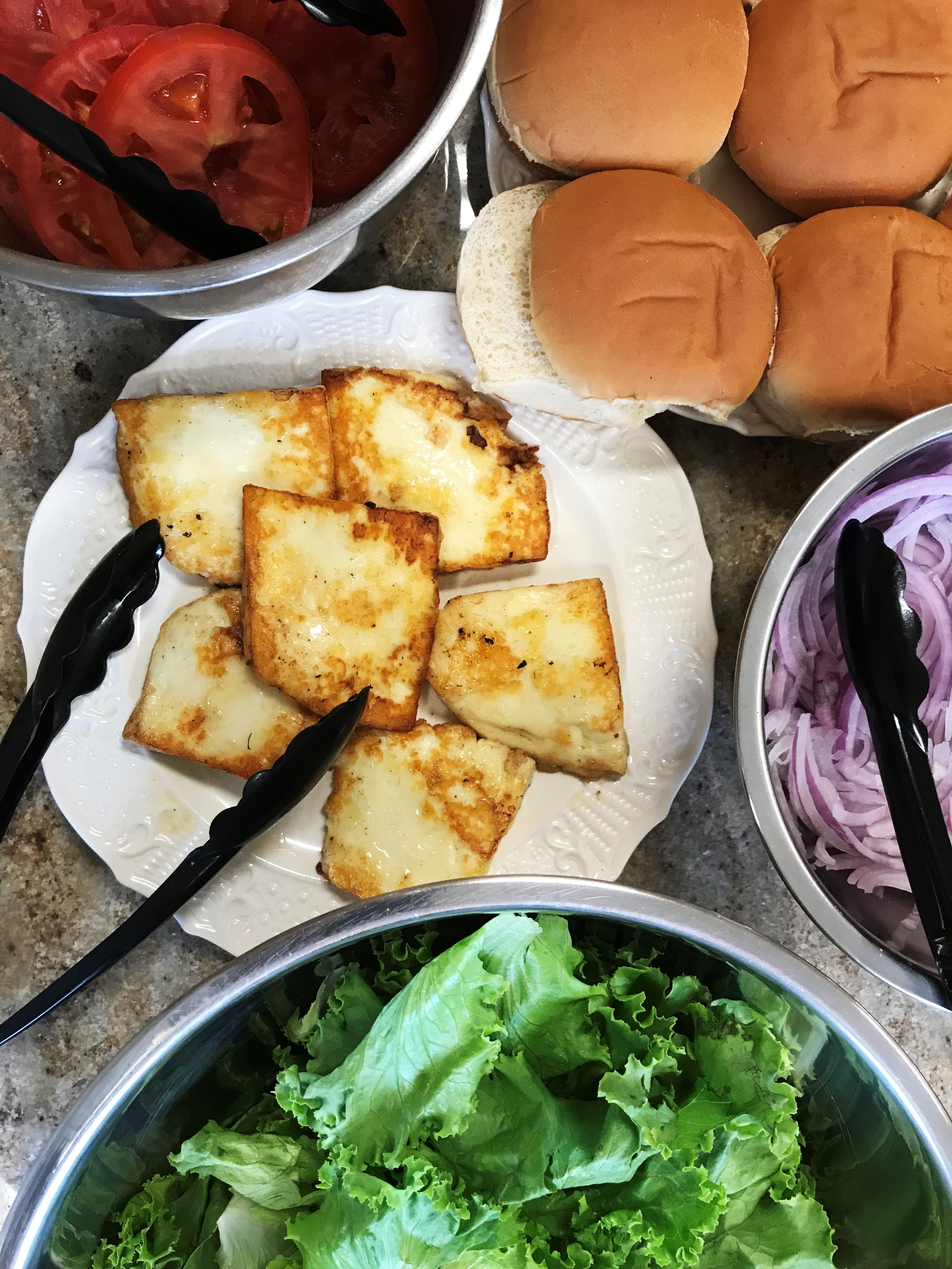 """Halloumi Cheese """"Burgers"""" ready to go with all the fixins."""
