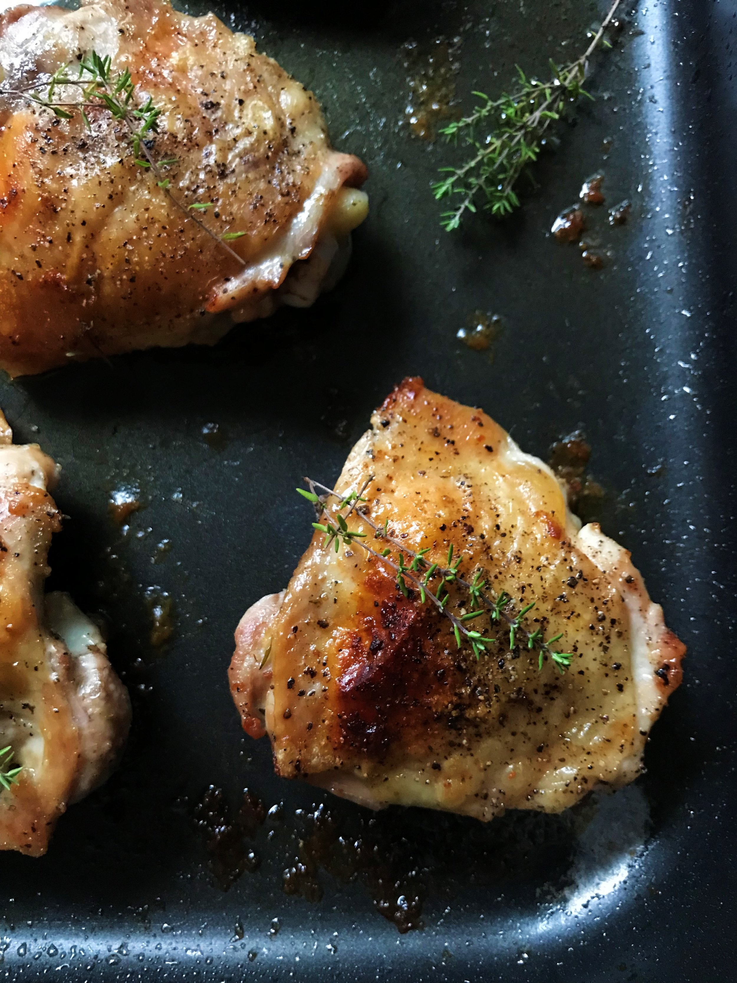 These babies are so tasty! Simple Baked Chicken Thighs made in the Adventure Kitchen (and about to be devoured by me).