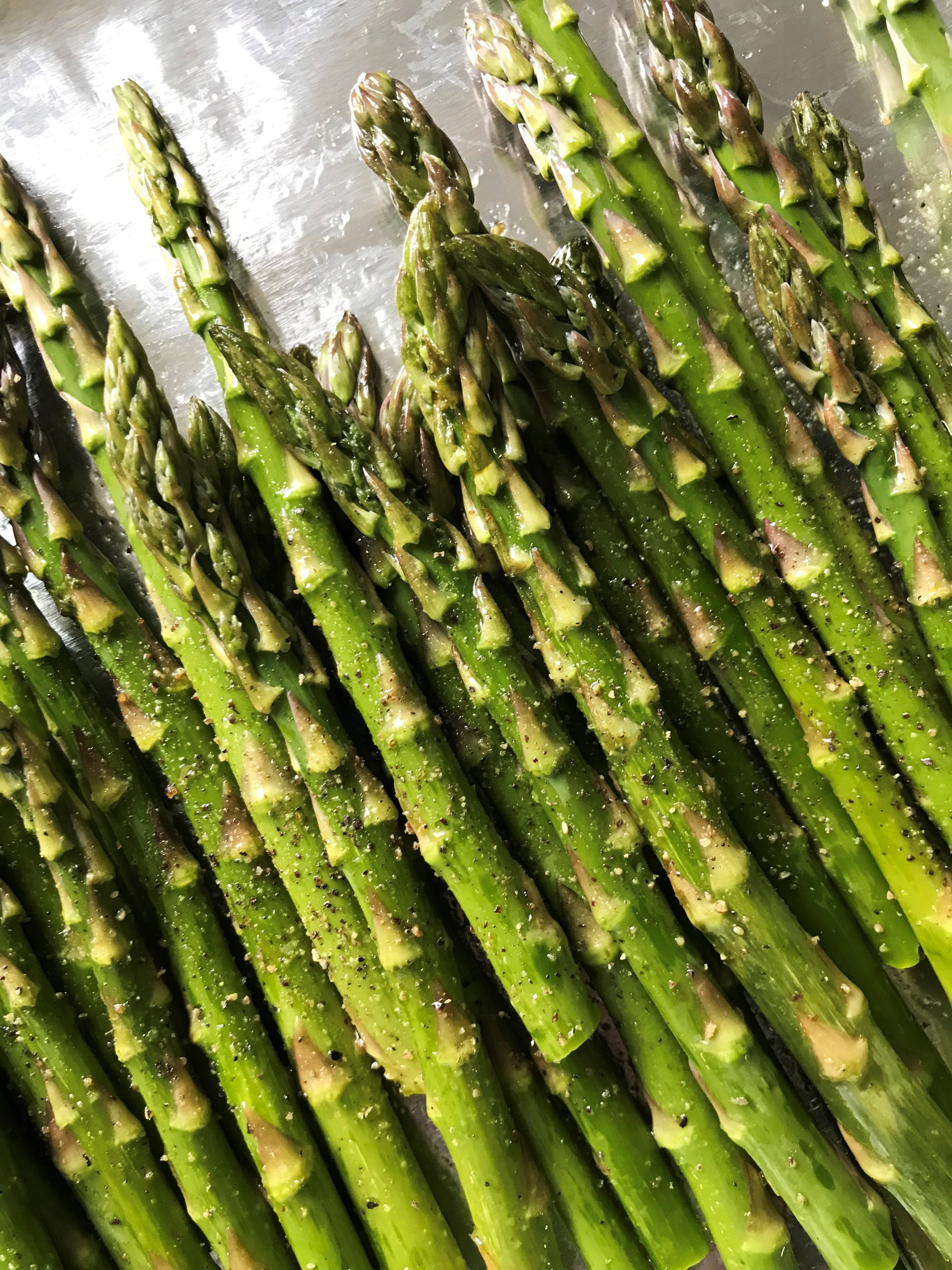 Pretty green asparagus spears ready to be roasted.