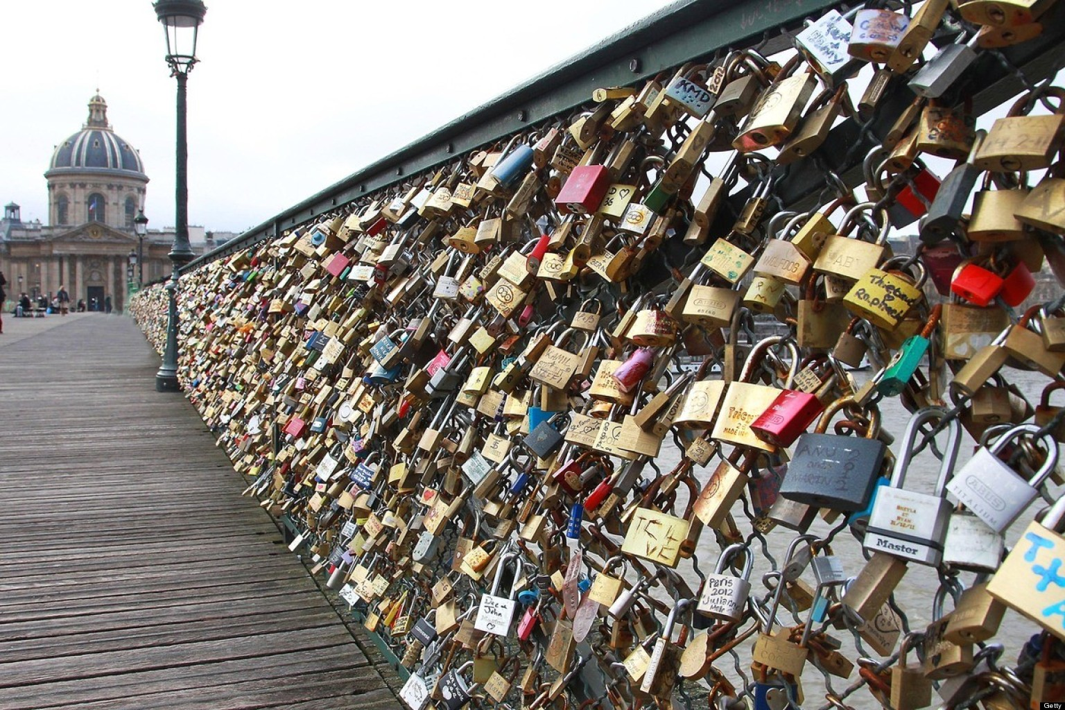 The tradition of attaching a padlock on the fence and tossing the key into the Seine River