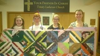 Youth quilting with Love Day.jpg