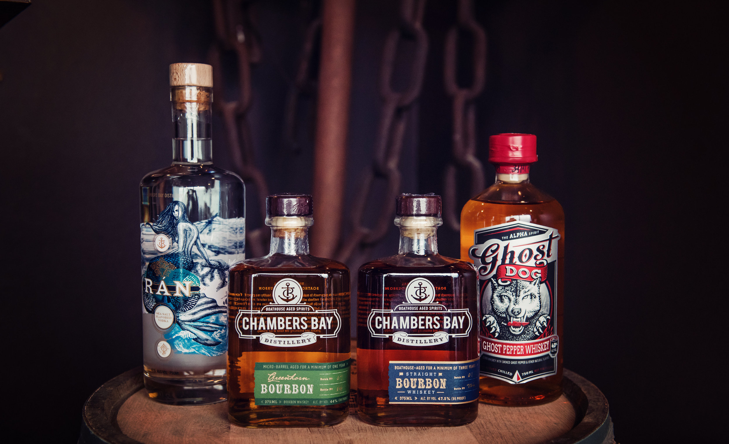 The Chambers Bay Distillery lineup, from left: Ran Vodka, Greenhorn Bourbon, CBD Straight Bourbon and Ghost Dog Whiskey. Photo credit: Elizabeth Brant