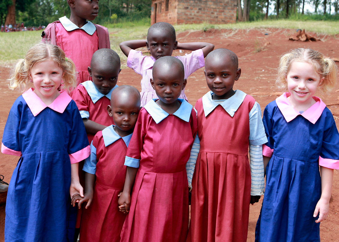 Ava and her twin sister Elise with students of Ndikwe School