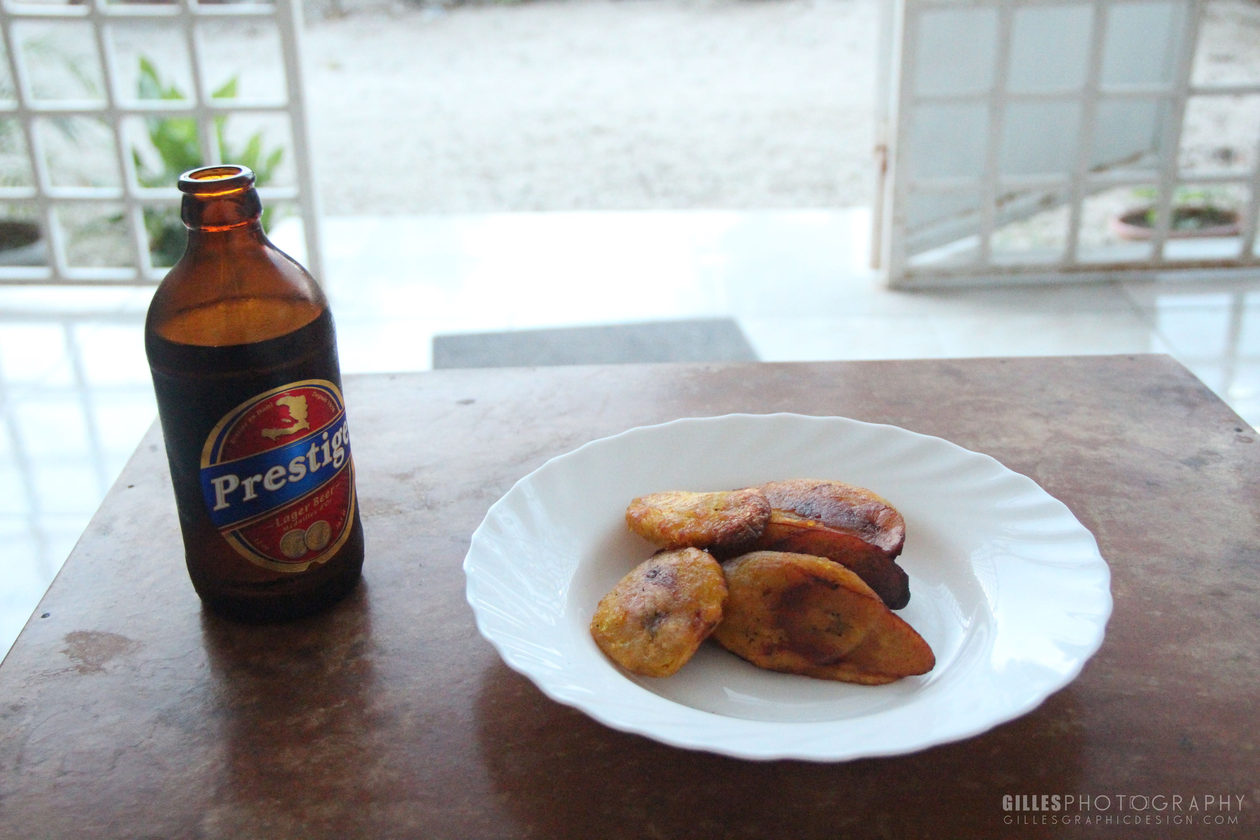 The common Haitian Meal: Prestige beer and Banan(plantains)