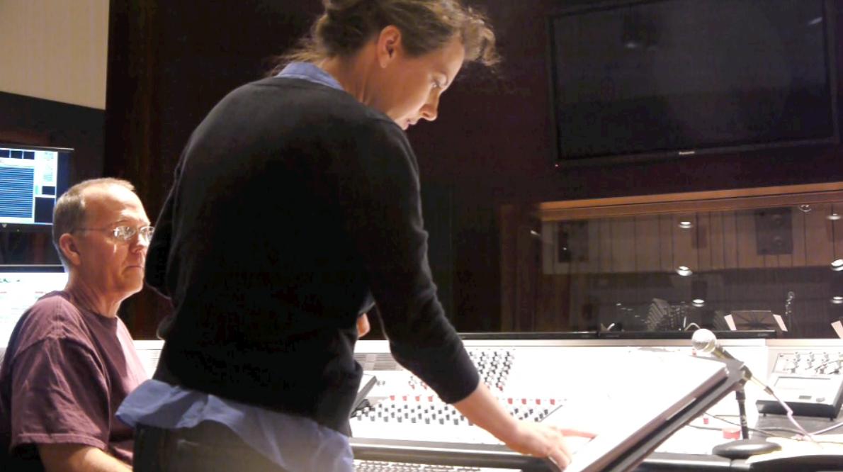 Joan at controls in studio.png