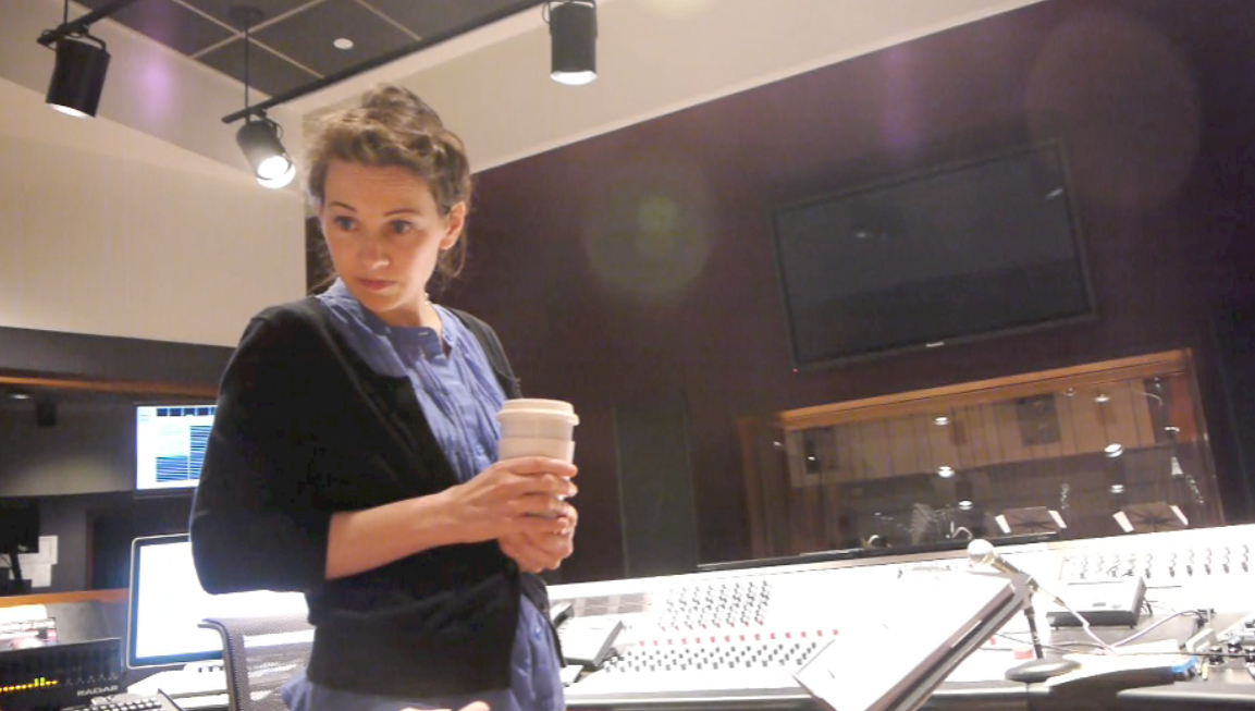 Joan with tea in mix booth.png