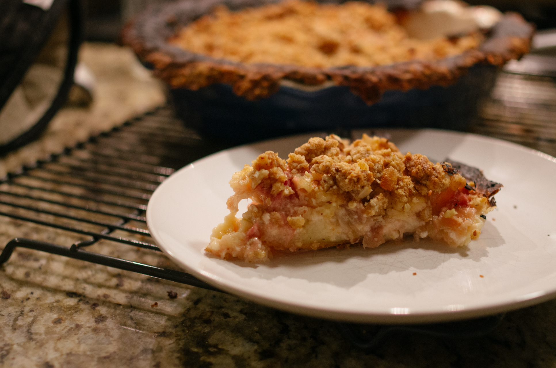 "Sour Cream Rhubarb Pie with Ginger-Pecan Streusel:  The note in the book says ""new fave fruit pie"". It's true. I am not a huge fan of fruit pies, even though I enjoy baking them, but I loved this. I was a bit nervous about the streusel, being that I am also not a huge fan of nuts, but it's so good and goes perfectly with the pie. The pie itself, my god! I had quite the adventure attempting to partially blind-bake the pie crust, and then burned the top of the crust in an oven mishap. It's fine! The pie was still so good! I love the custardy filling that goes over the rhubarb. I'm gonna go get a slice right now, actually."