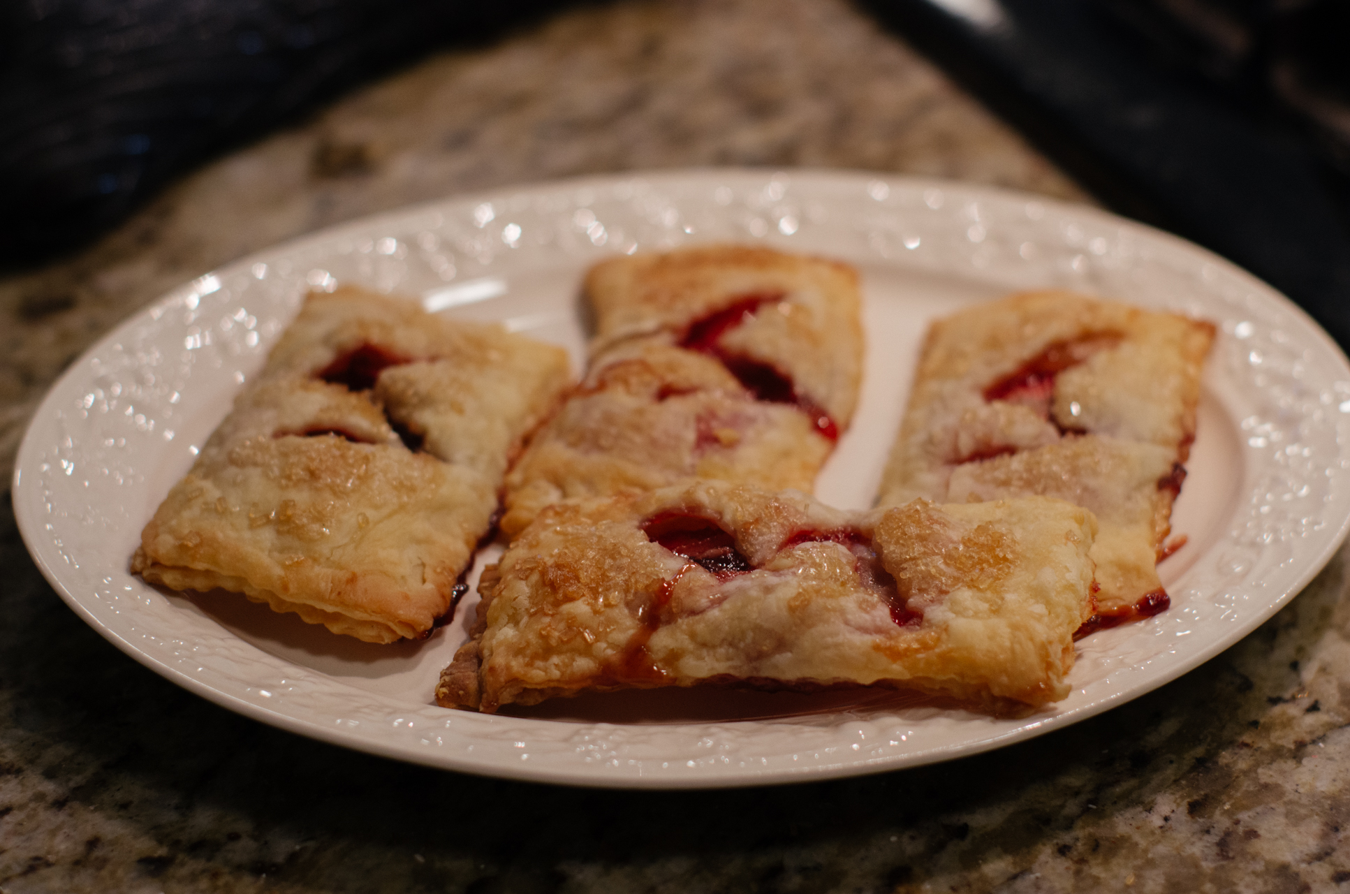 Strawberry Hand Pies:  I had leftover pie dough, which was a godsend; when my girlfriend and I decided we wanted to try this, we didn't have to wade through the process of making the dough (aka putting myself in temptation's way…I still ate some dough, though). These are like Pop-Tarts without the weird box art that suggests Pop-Tarts cannibalize themselves.