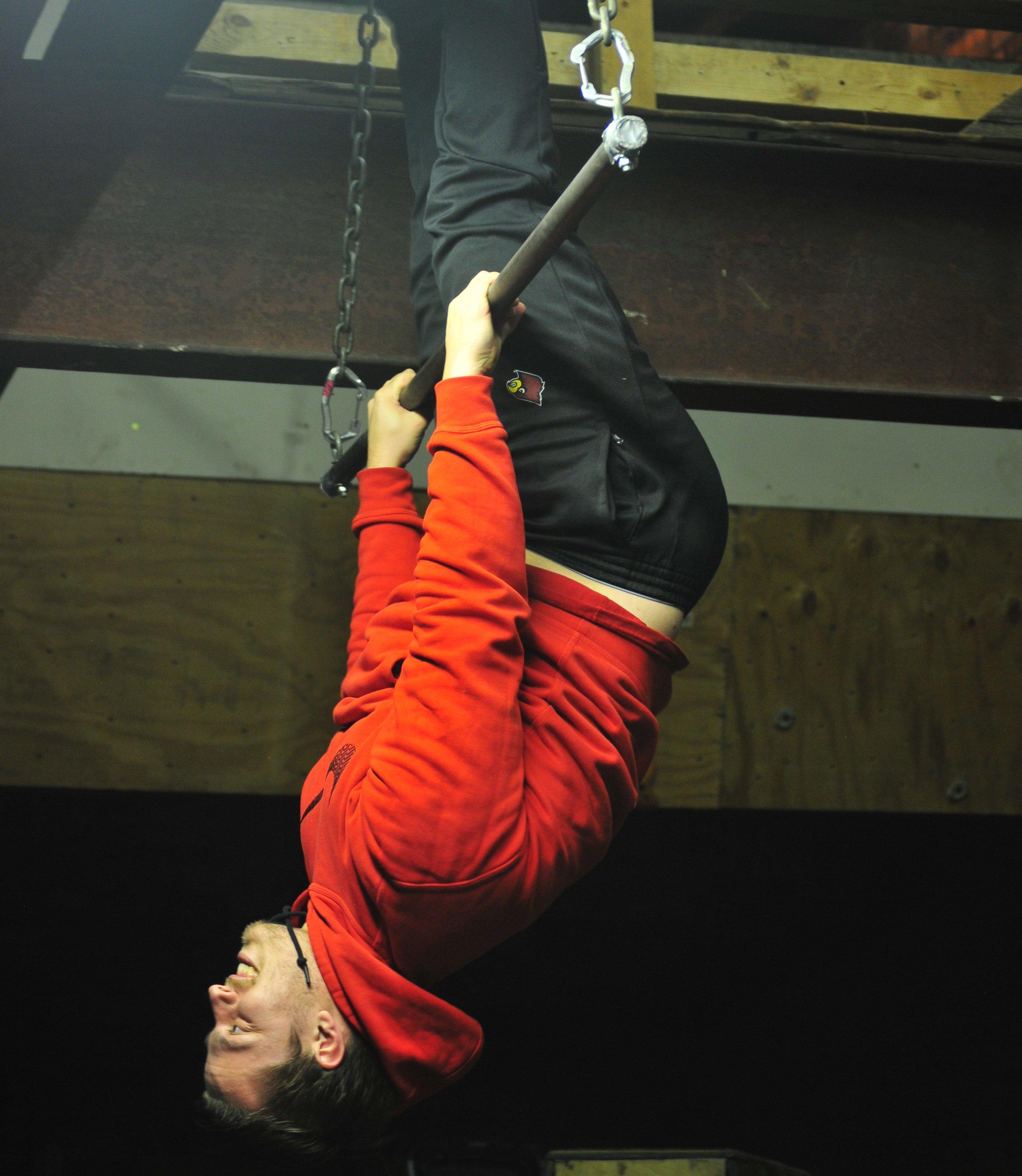 Nils hanging upside down.jpg