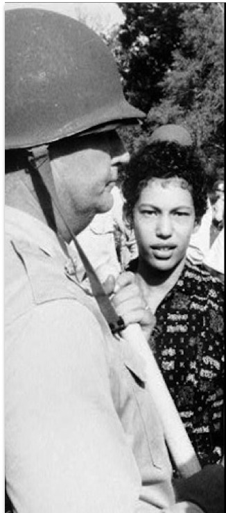 Carlotta Walls escorted into schoolby the Arkansas National Guard in 1957 by the order of President Dwight D. Eisenhower