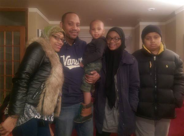 Jihad Ahmed with four of his eight kids: (left to right) Ahmed's daughter Ahmed (20), son Suhayb (3), daughter Ameenah (17), and son Aqil (15).    Jihad Ahmed