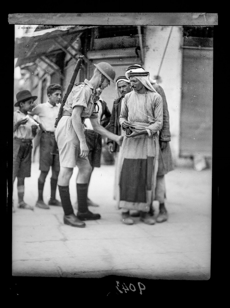A British soldier searches a Palestinian citizen. 1936