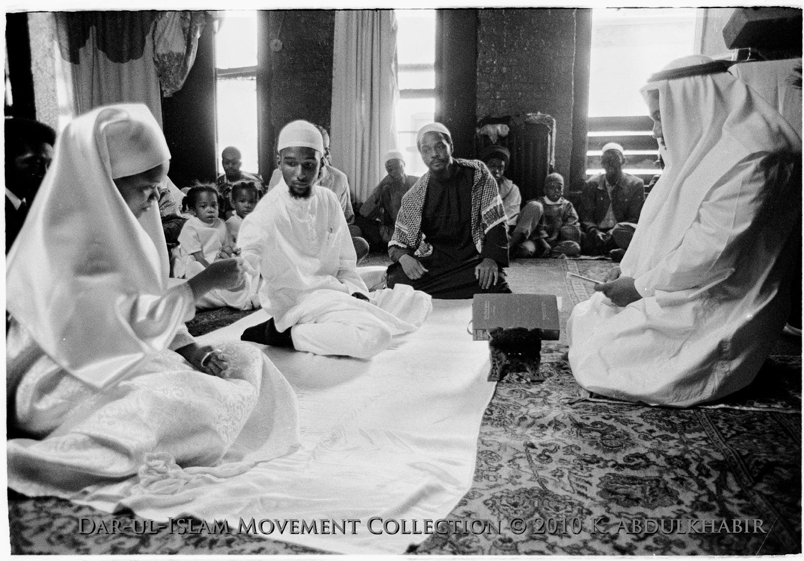This wedding photo taken at Yasin Masjid in 1971 by Dar ul Islam Movement photographer Khalil AbdulKhabir at the ceremony of Mahmoud Andrade Ibrahim and Karima Amatullah, aided in establishing Islam as a cultural reality within the imagination of the larger African American community.