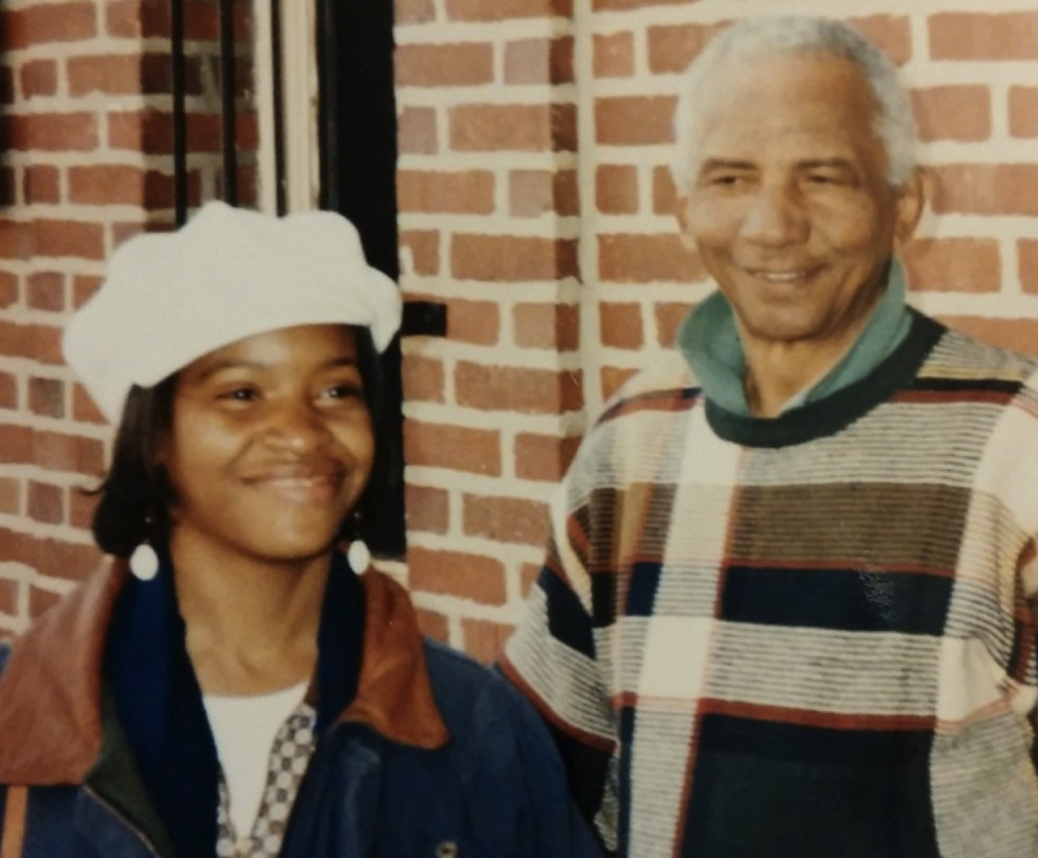 Abdur-Rahman, left, meets actor Al Freeman Jr., who played Elijah Muhammad in the movie Malcolm X, on the campus of Howard University a few years after the film's release.