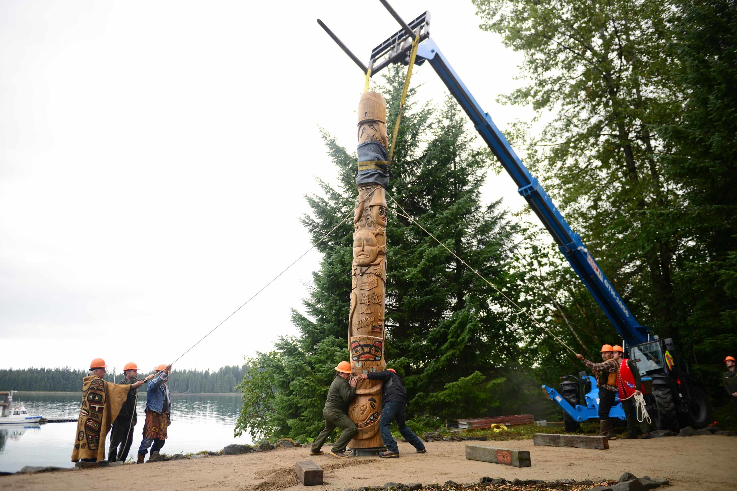 A healing pole is erected in Bartlett Cove in Glacier Bay National Park, representing a new chapter in the relationship between the National Park Service and the Tlingit people, who worked collaboratively to build a new clan house in the Cove, prioritizing the area's cultural significance and restoring access to its descendants. The Huna Tlingit were pushed out of the their traditional homelands by advancing glaciers during the Little Ice Age of the 1700s, and kept out by federal laws as the ice receded. June 2018.