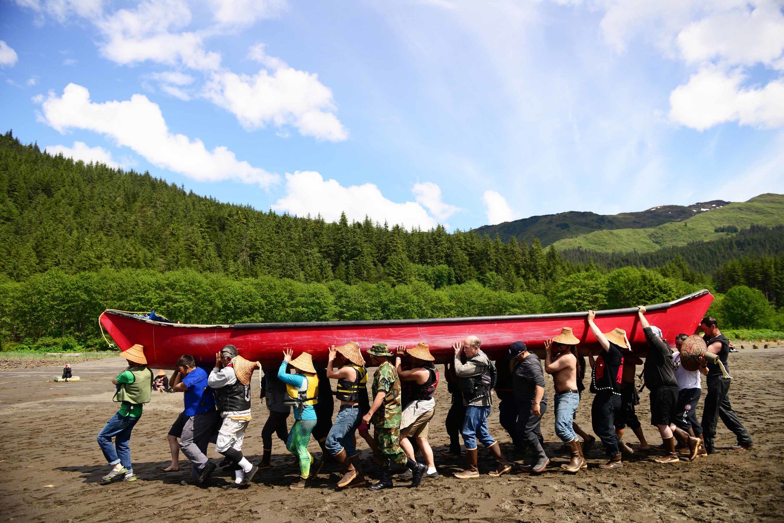 Southeast Alaska's biennial Celebration of its Alaska Native heritage begins as paddlers arrive in Juneau after long canoe journeys from around the region. Paddlers including Gov. Bill Walker carry a vessel down to the water to join the last leg of the journey. June 5, 2018.