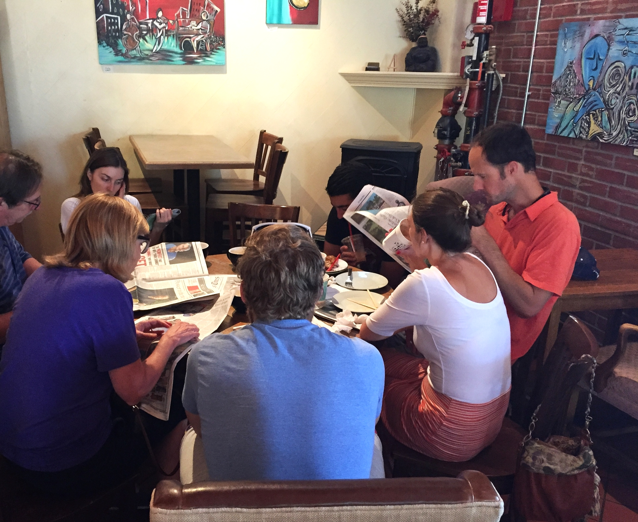 Family relaxing at West End Cafe