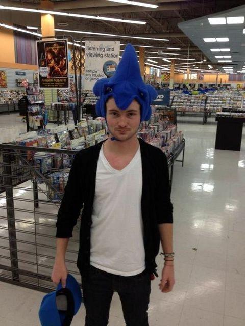 Joe trying on new hats