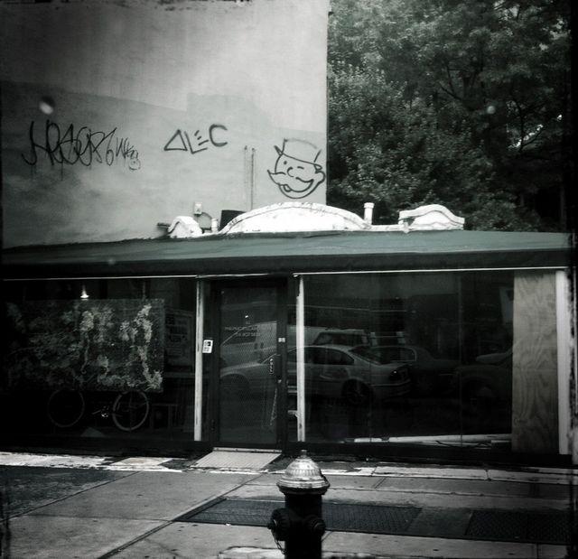 I spy Mr Monopoly grafitti above a restaurant