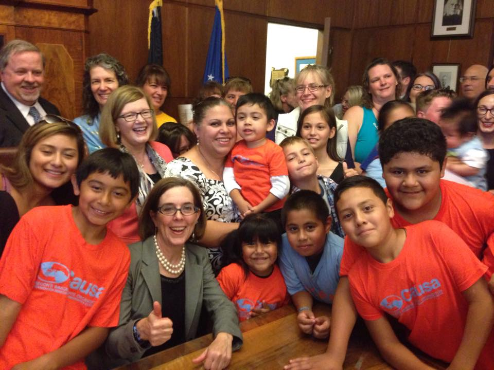 Causa members with Governor Brown after she signed paid sick days legislation.