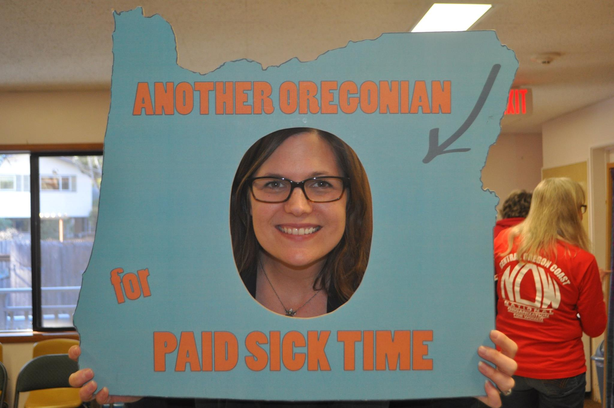 Executive Director Michelle Ganow-Jones supporting paid sick days at an Oregon NOW annual meeting.