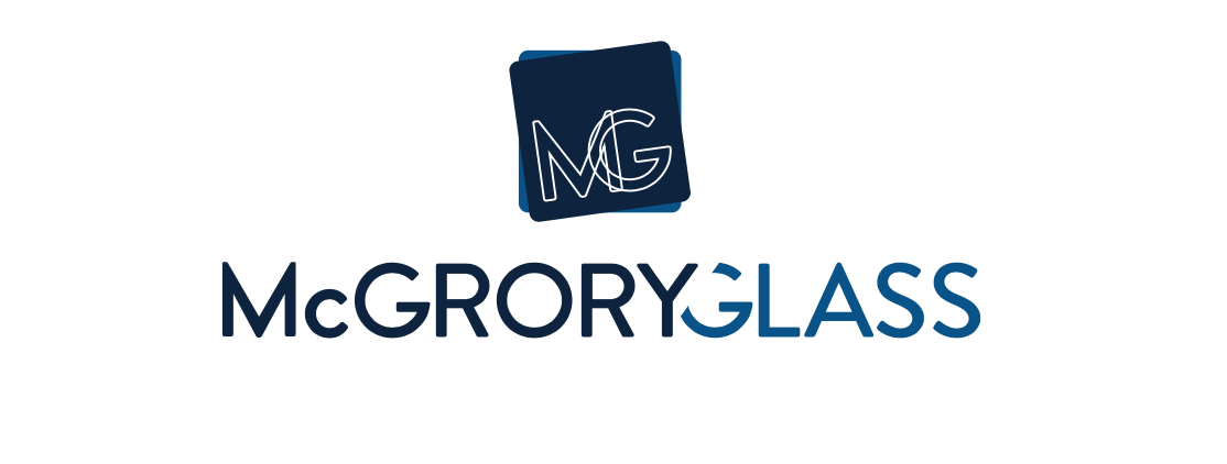 The refreshed McGrory Glass logo, which retains the blue mark for continuity but updates the typeface to reflect a more modern, sophisticated company.
