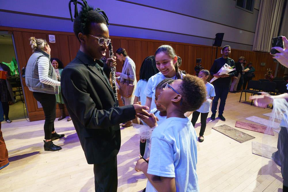 Oboist Mekhi Gladden with singers from Girard College after the Anansi premiere.
