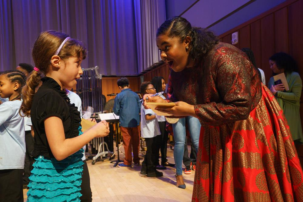 Soprano Lindsey Reynolds giving an autograph after the Anansi premiere.