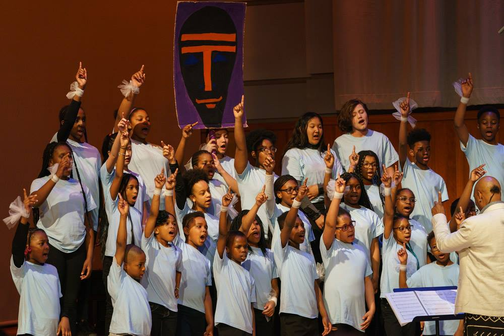 The Girard College Choir sings their role as Nyame, the god of all things.