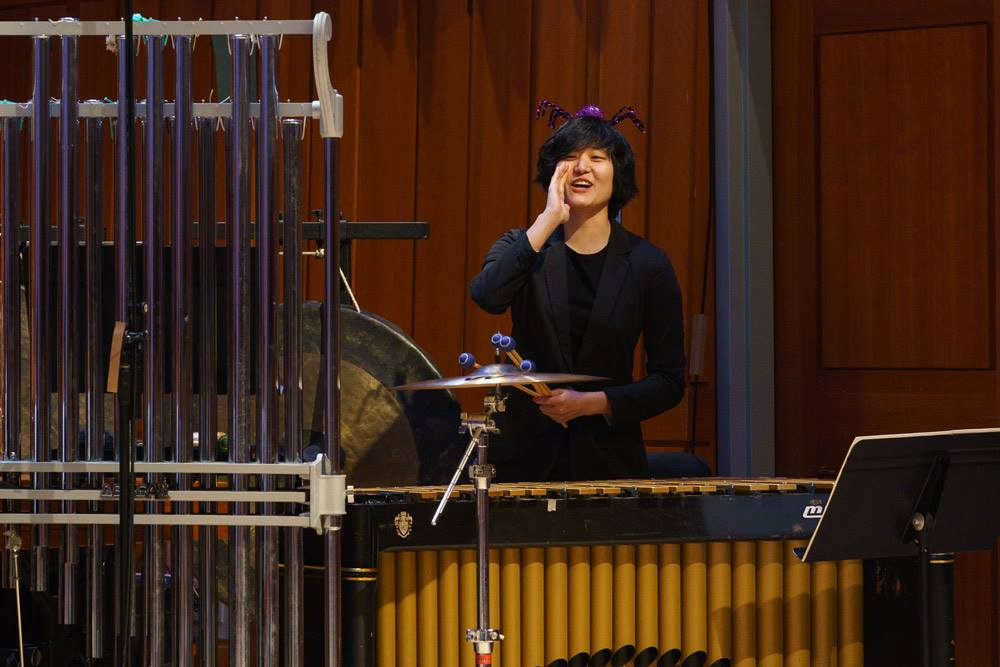 Percussionist Hanna Kim involves the audience during the Anansi pre-show.