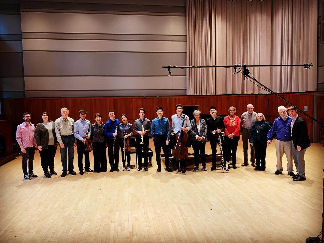 Participants, performers, and composers gather after a concert of Penn Memory participants' works.