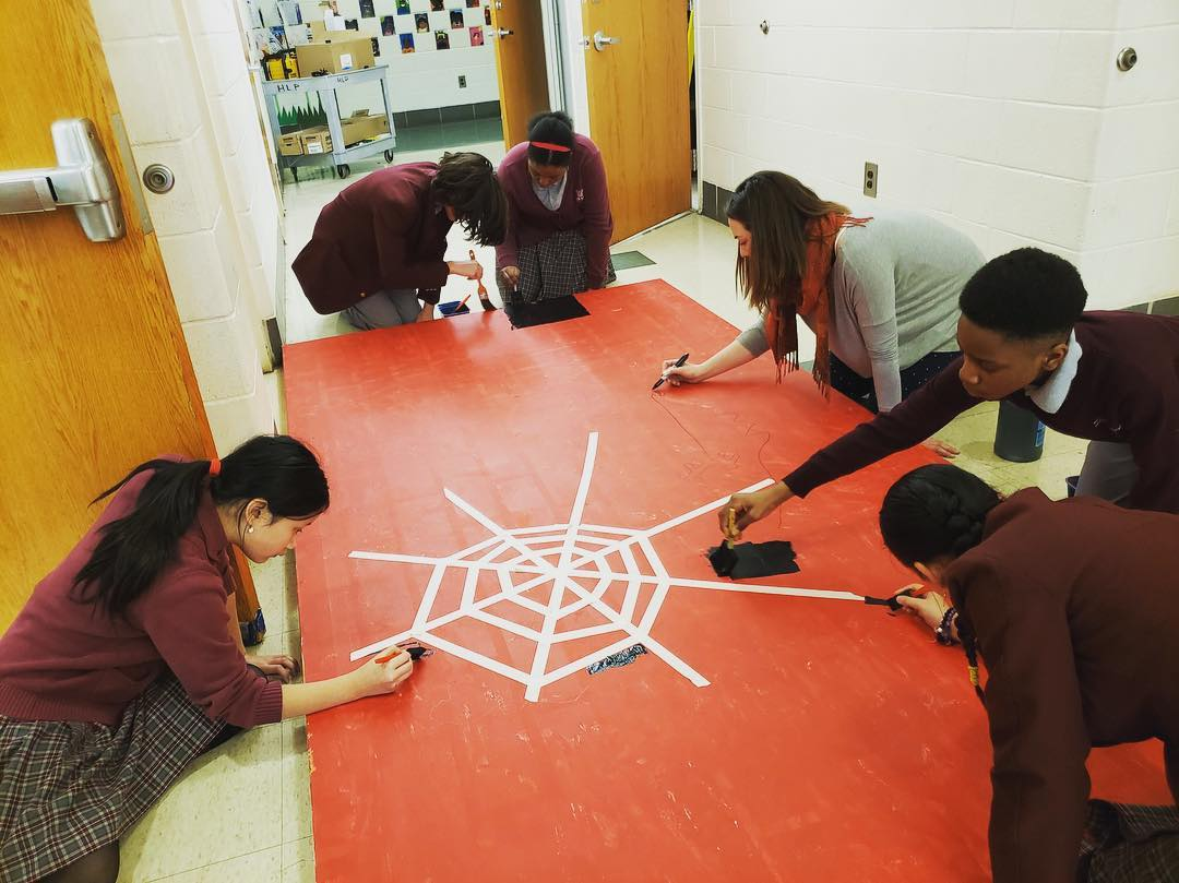 Girard College high school students hard at work on the set for Anansi.