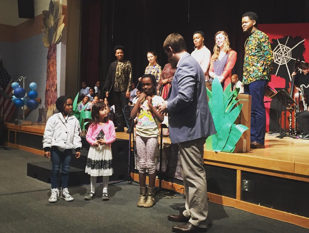The creative team with audience members at Girard College during the Anansi pre-show.