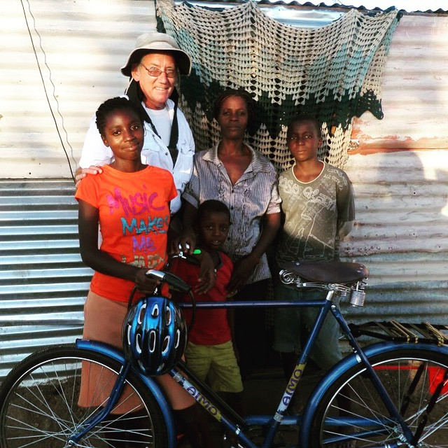 Larry presenting the top student at Five Rand Primary School with the 7th annual bicycle award to the top student, Ester Reino.  Another student achieving rewards for outstanding effort without the benefits of electricity or running water.  #Leadership #DevelopmentWork #SustainableDevelopment #WomensEmpowerment #InternationalAid #NonProfit #Namibia #Okahandja #OpenHands #Africa