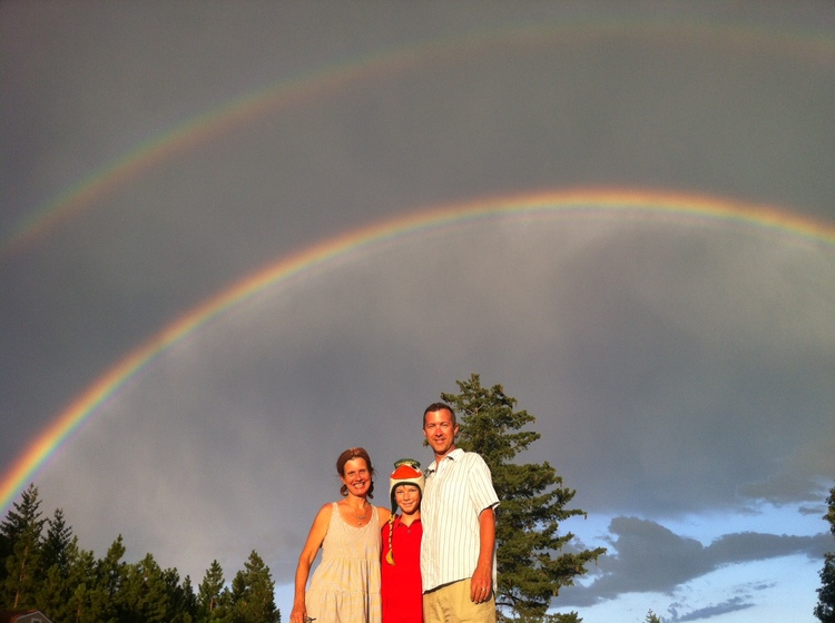 Jnana and her family under a Double Rainbow in Mt. Shasta