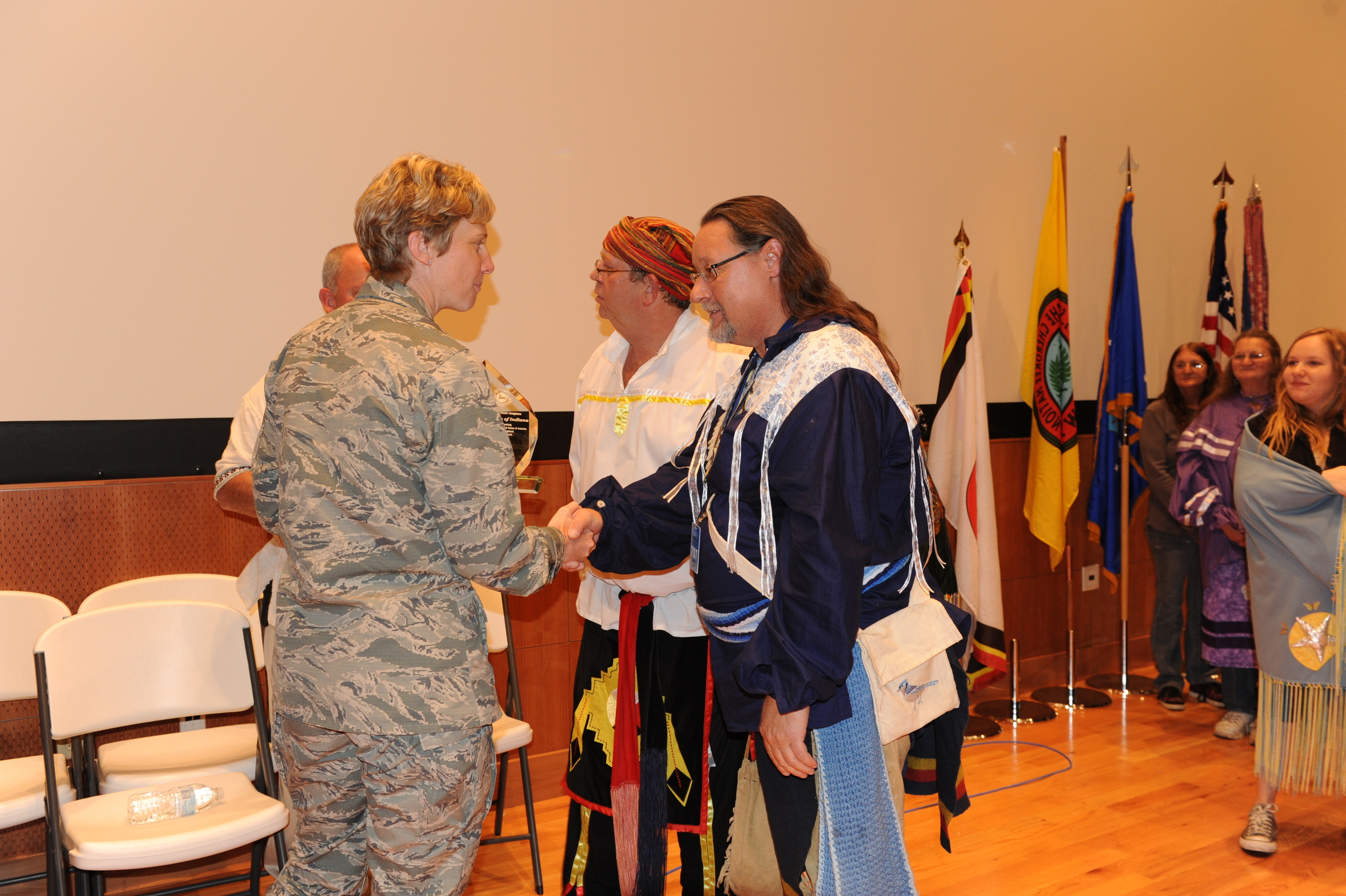 The Indiana Miami receiving a Recognition award from the Base Commander.