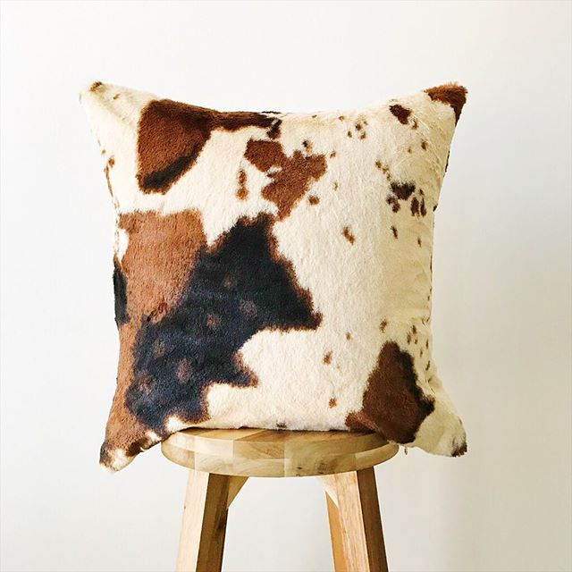 The popular cow 🐮 print will be available @rockbrookvillage on May 5th! This faux fur pillow is ridiculously soft 💕 . . . . #decorcrushing #midwestisbest #shopsmall #smallbusiness #lumbarpillow #hygge #foryourhome #throwpillows #etsyseller #pillowlove #homesweethome #interiorinspo #homedecor #interior4all #interiordesign #smallbiz #throwpillowcover #softpillows #nebraskagram #thatsdarling #decorlove #pillowlover #omahaevents #machinewashable #livecolorfully #thesablefox #etsyshop #rockbrookvillagecraftfair #cowhidepillow #fauxfurpillow