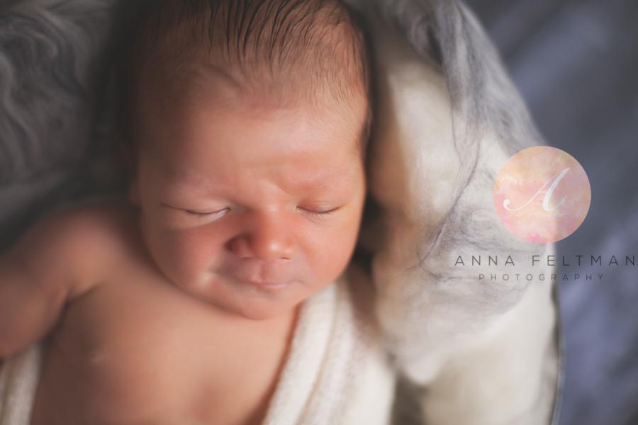Newborn smiling baby Orlando.jpg