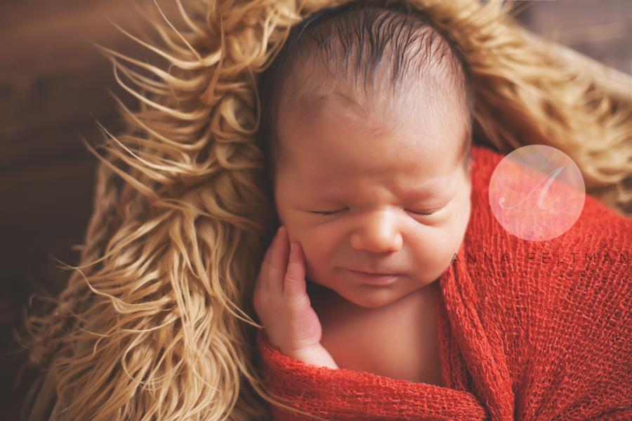 Baby smiling newborn orlando.jpg