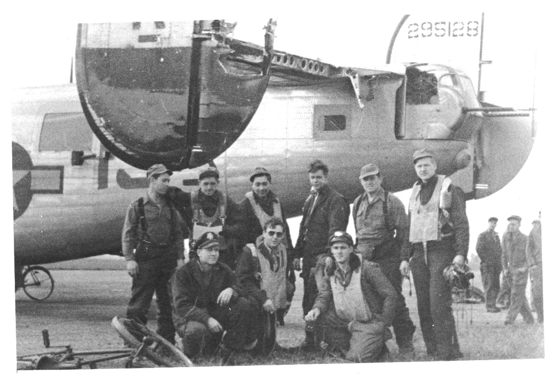 14 September 1944 - The Bruce Crew poses in front of a wrecked Bonnie Vee after bringing her back from a mission to Fismes, France. They had left the U.S. aboard the Bonnie Vee, named for Bruce's wife, but had her taken from them upon arrival in England. Reunited, but not for long, their copilot, John Willett,was badly hit yet heroically fulfilled his duties on this mission. The crew would reunite one more time with Bonnie Vee on a fatal mission nearly two weeks later when seven of them would fall to their deaths, including their new copilot. Stories below.