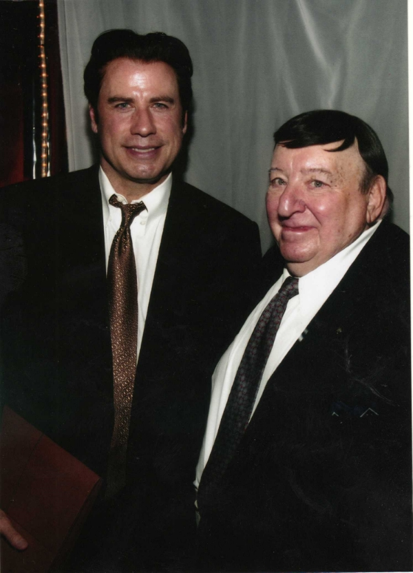 """John Travolta and Herb Schwartz, Fall 2008 in Kansas City. In Travolta's right hand, a file containing """"everything I had on the Kassel Mission,"""" said Schwartz, who died two months later."""