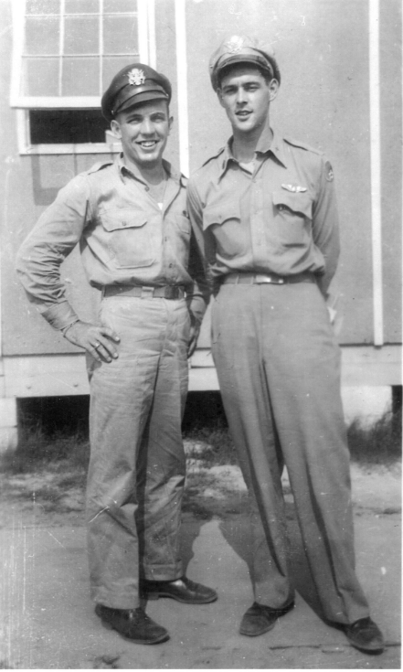 Lt. Bruce, right, talks with his original copilot, Lt. William Brown. Brown was injured prior to the Kassel Mission and removed from the crew.