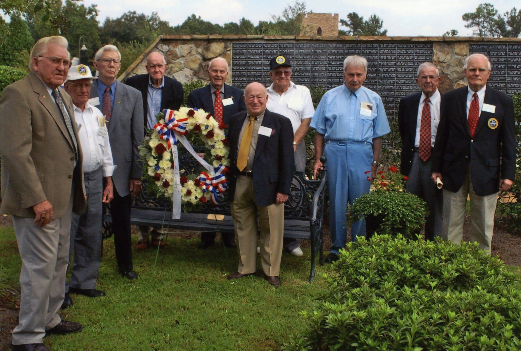 Fall, 2007 in America. Kassel Mission and 445th BG veterans stand in front of the newly dedicated 445th BG bench at the Mighty Eighth Museum in Pooler, Georgia in 2006.